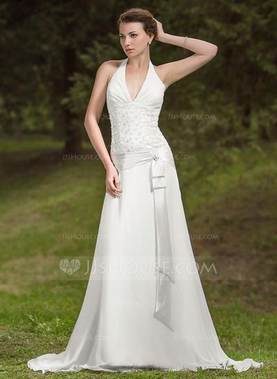 Vestido de noiva com laço.